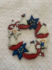 Nancy Thomas Folk Art painted wood wreath with stars and sailboats