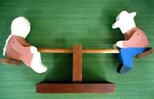 HAND CRAFTED FOLK ART BOY AND GIRL ON TEETER TOTTER