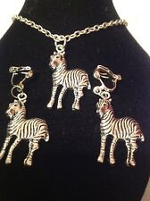 zebra necklace and matching clip on earrings silver plated