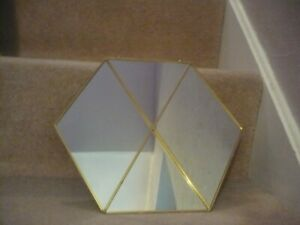 HEXAGON SHAPED MIRROR WITH A BRASS COLOURED METAL FRAME AND CHAIN