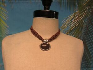 """Necklace with Multi Strands of Brown Beads and a Brown Bead Pendant 14"""""""