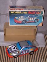 VINTAGE YONEZAWA TIN B/O PORSCHE 911 RALLY CAR W/ORIGINAL BOX. FULLY OPERATIONAL