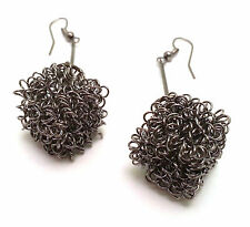 Dangling Metal Earrings with a Cubic Tangled Chain Style