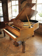Antique, Steinway Model A grand piano with a walnut case and fluted, barrel legs