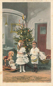 Hold-To-Light Christmas Children Playing With Their Toys Postcard