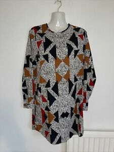 Very attractive longer Length Tunic top by Boohoo. Size 8. Worn once