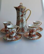 Japanese Kutani Moriage Chocolate Pot and 4 Cups and Saucers Meiji Period Signed