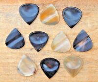 10 Real Buffalo Horn Guitar pick with hand carved groove and thumb impression