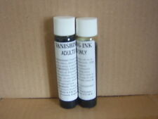 2 bottiglie di VANISHING / scomparendo ink.sprinkle su Bianco material.joke Trucco