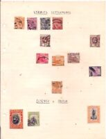 14 old STRAITS SETTLEMENTS + BORNEO +PAPUA stamps on an album page.