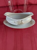 "MEITO CHINA  OVAL GRAVY BOAT WITH ATTACHED UNDERPLATE 9"" W 2 1/8D MADE IN JAPAN."