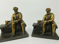 Vintage President Abraham Lincoln Metal Bookends Sitting on a Bench