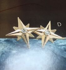 14k yellow gold star earrings with real diamonds.