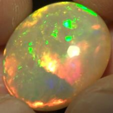 23.60 ct Spectacular Round Cabochon Ethiopian Opal  ( See Video !! )