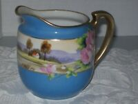 """VINTAGE NORITAKE CREAMER IN BLUE WITH HAND PAINTED SCENE AND PINK ROSES """"M"""" IN W"""