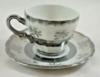 SILVER AND WHITE FLORAL CUP AND SAUCER - MADE IN JAPAN