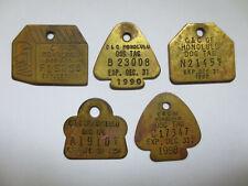 HONOLULU BRASS DOG LICENSE TAGS (5) Brass
