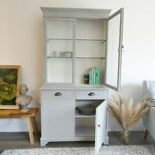 Grey French style kitchen dresser with brass knobs and etched glass doors