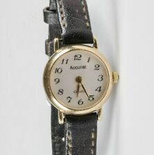 Ladies Accurist 9ct Gold Quartz Watch with leather strap.