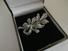 Vintage silver metal marcasite brooch designed as leaves in a tied bow