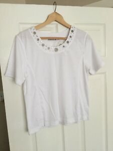 Ladies White  T Shirt with a  stud and hole pattern around the neck BNWT