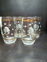 vintage MCM barware set of 4 glasses with white knight & stars, and gold bands