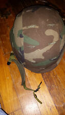 US PASGT helmet with woodland camo cover