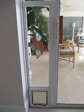Glass vinyl vertical window with pet, dog cat door, 7x10 flap, 20-26 high by Cat