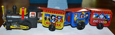 VINTAGE ZIG-ZAG TIN TOY WIND UP TRAIN, WITH FLAG, WORKS GREAT