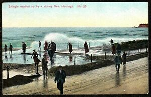 1910 HASTINGS SHINGLE WASHED UP BY A STORMY SEA POSTCARD SUSSEX