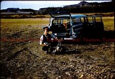 1950s Hunter with camera deer and 1957 Chevrolet station wagon 35mm Slide c106