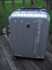 """DELSEY HELIUM TITANIUM 21"""" HARD SHELL SPINNER CARRY ON SUITCASE SILVER"""