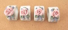 4 white with 3-D pink roses D-shape napkin rings porcelain green leaves blue rib