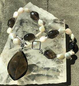 SMOKEY QUARTZ and FRESHWATER FLAT PEARLS accent a chunky SMOKEY QUARTZ pendant.