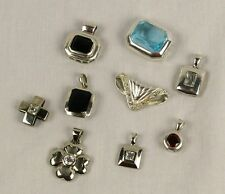 A collection of .925 Sterling Pendents with CZ stones