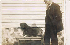 RPPC Real Photo Postcard ~ Man Watches Cute Little Dog Sitting On Table ~ Dog