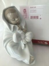 NAO by LLADRO' All bundled up 02001340 statuina porcellana