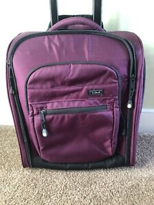 LL Bean Plum underseat bag, roller rolling and computer case