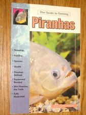 LOT # 17 - TWO BOOKS ON PIRANHAS - natural history and field guide