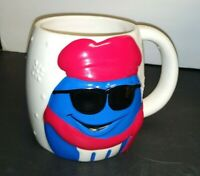M&M Blue In Hat And Scarf coffee mug