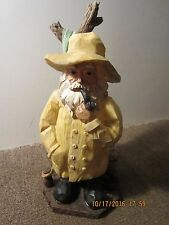 Faux Wood Statue Of Fisherman At Dockside