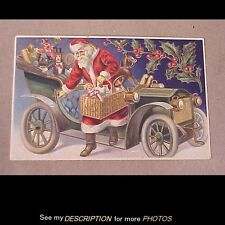 1908 Santa Claus Getting Out of a Car WIth a Basket of Gifts Embossed Postcard