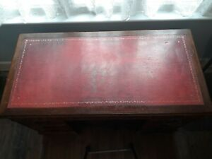 Antique Victorian dark wood pedestal desk with red Morocco leather & gold top