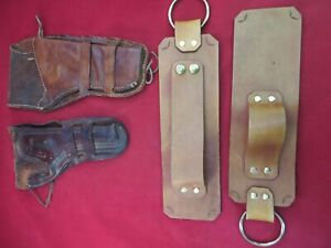 TWO VINTAGE WESTERN HOLSTERS AND A LEATHER RIFLE WALL MOUNT