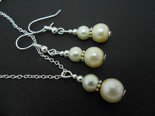 AN IVORY PEARL   NECKLACE AND EARRING SET. NEW.