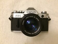 [EXCELLENT] Canon AE-1 35mm Film Camera W/ 50mm F/1.4 FD Lens New Light Seals