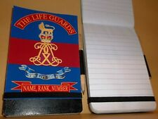 The Life Guards notebook with elastic band and pencil.