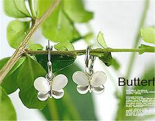 Pretty white resin silver tone butterfly hoop earrings