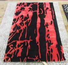 Safavieh Black / Red 5' x 8' slightly damaged rug for reduced price