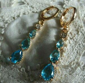 Ohrringe, gelbgold-gefüllt, mit je 3 x Blau-Topas